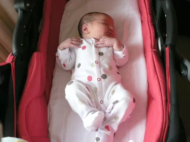 N as a baby in a carrycot