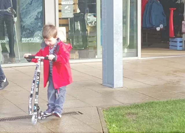 scooting along and checking out his scooter strap