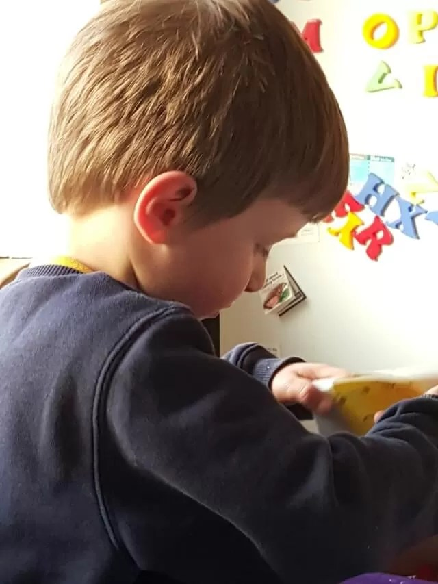 learning letters with fridge magnets
