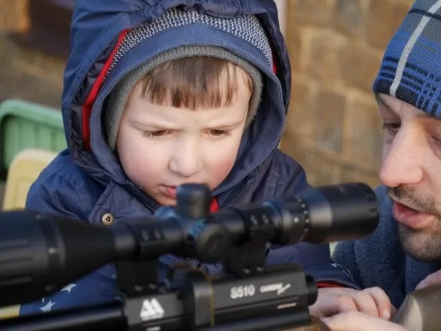 concentrating on learning about a gun