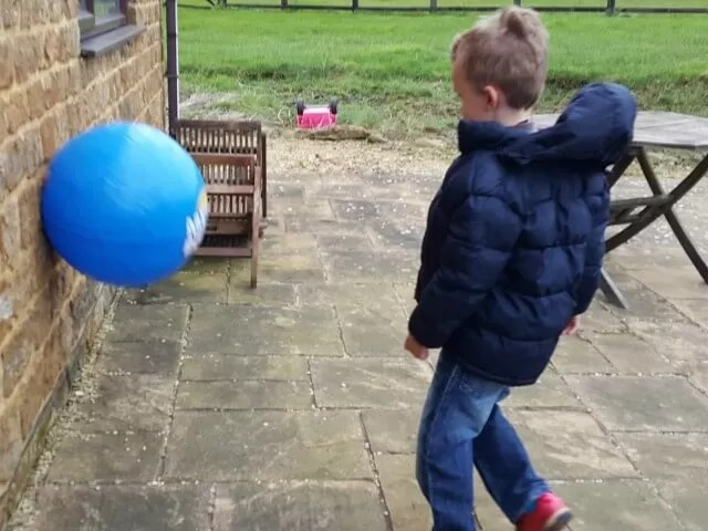 kicking the mega bounce against the wall