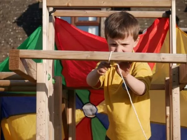 making a tent fort on a climbing frame