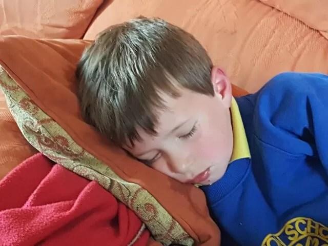 headache sleeping boy