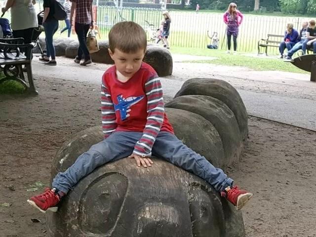 sitting on the playground caterpillar