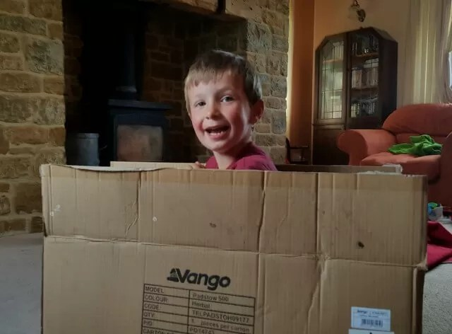 playing with cardboard boxes