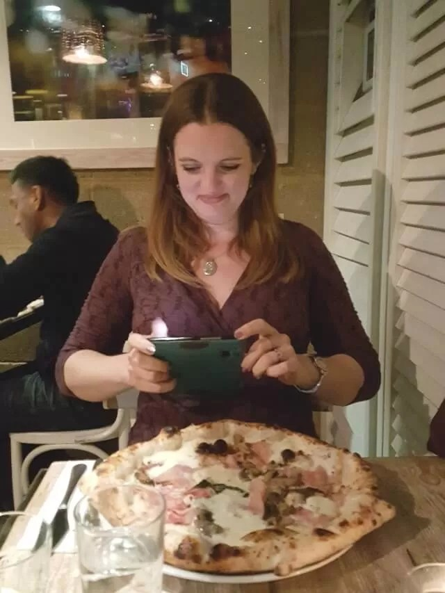photographing pizza in a restaurant