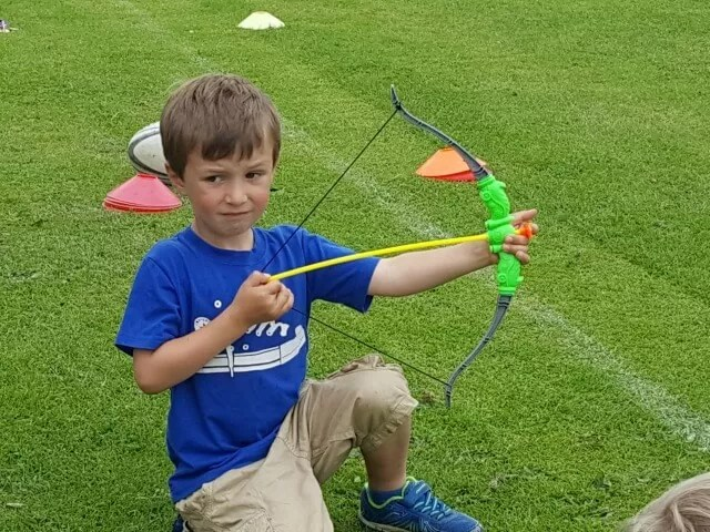 playing bow and arrows at a party