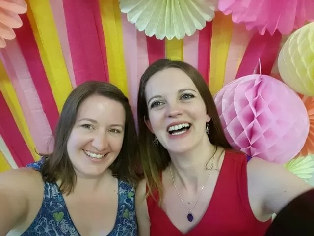 selfies at blogtacular with paper decorations