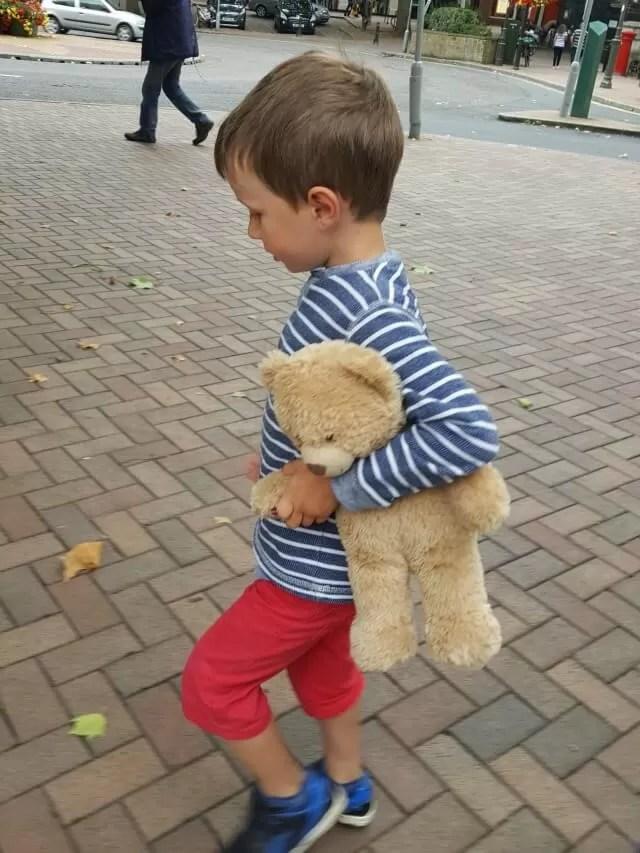 walking with a teddy bear