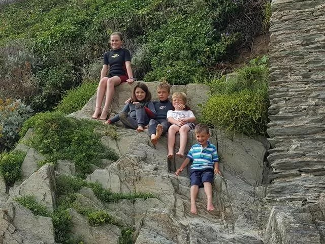 sitting on the rocks at Woolacombe with friends