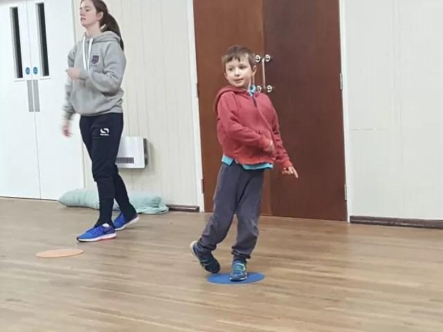 practising tennis ball throw