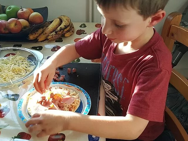 making your own pizza at a playdate