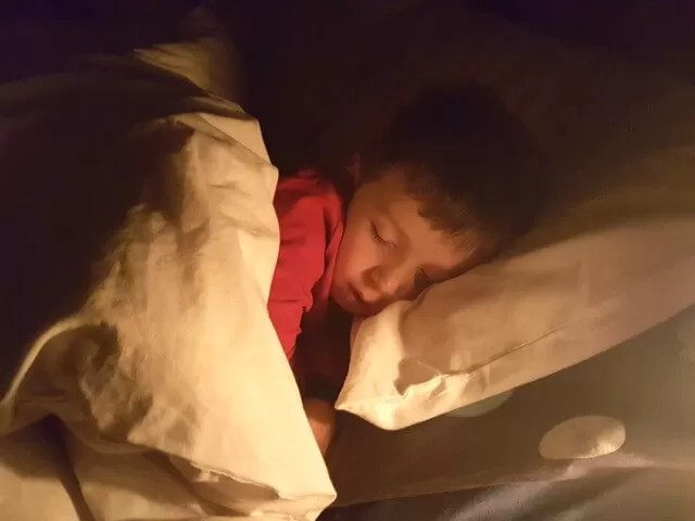 sleeping boy in bed