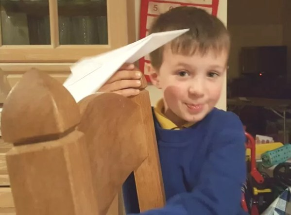 paper aeroplane flying