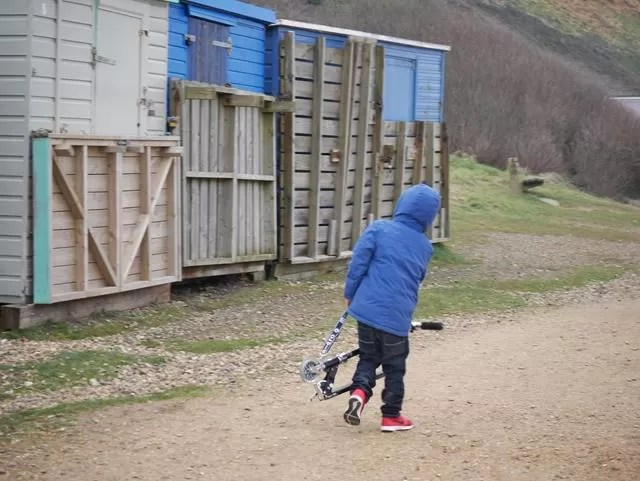 carrying his microscooter at Barton on Sea