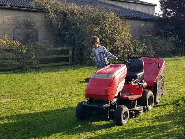 checking the lawn mower