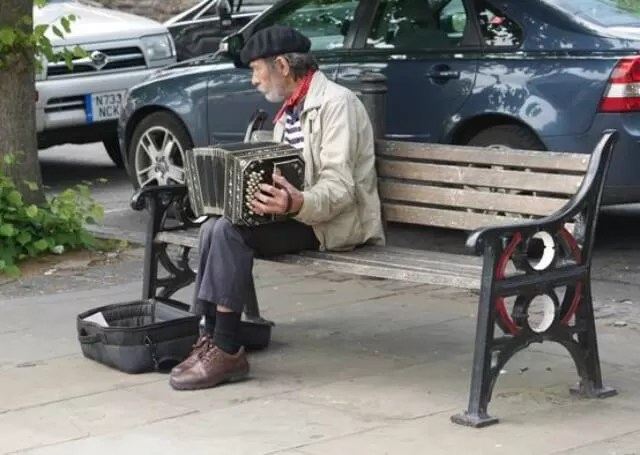 man playing accordian by Chester river dee