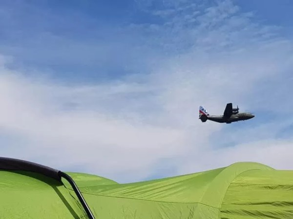 low planes over the tent