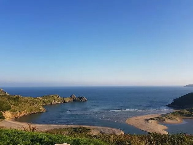 3 cliffs bay with the tide in