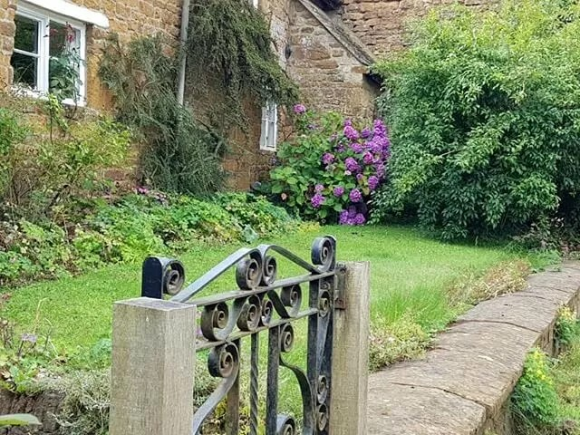 pretty cottage gate and garden