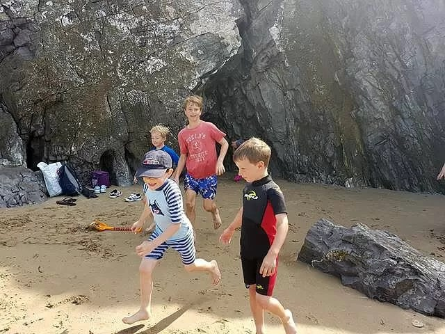 exploring caves at caswell bay