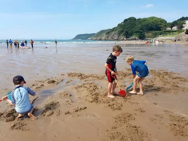 friends digging at caswell bay