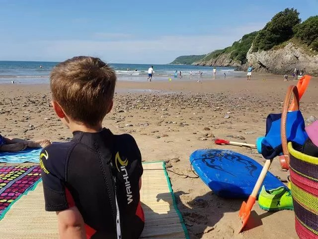 relaxing on the beach at caswell bay