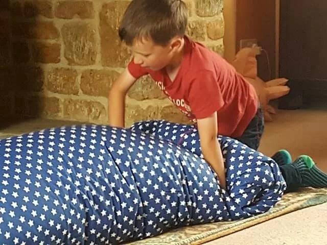 rolling up a new duvet