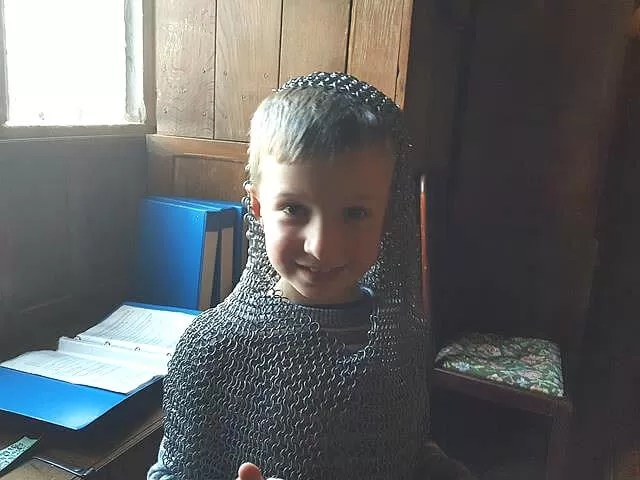 trying on a chain mail hood