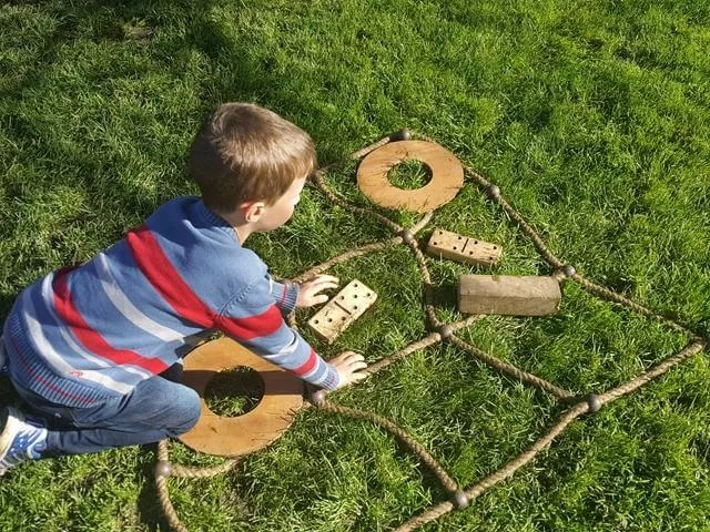 playing outdoor noughts and crosses