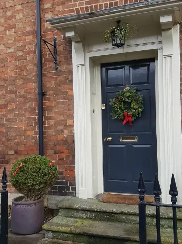 christmas wreath on navy door