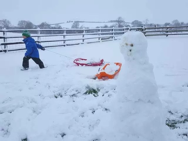 next to his snowman