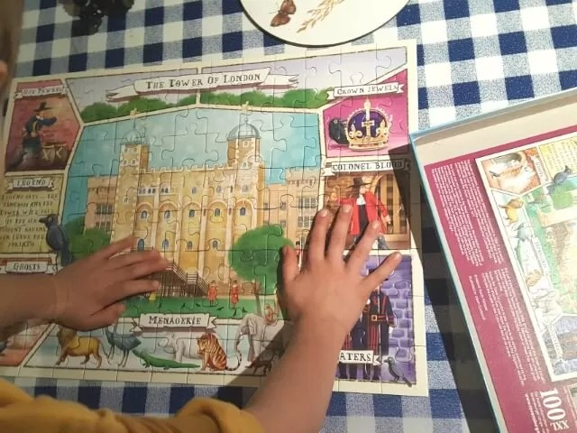 enjoying a 100 piece tower of london jigsaw puzzle