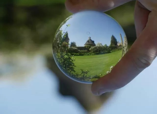 lensball view of pigeon house and gardens at rousham