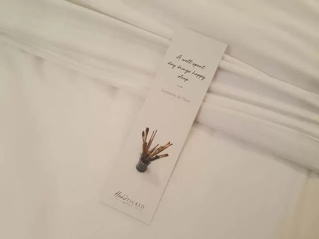 sleep quote bookmarks left on the beds