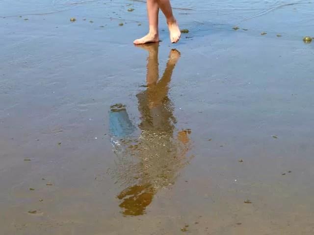 walking on wet sand reflection
