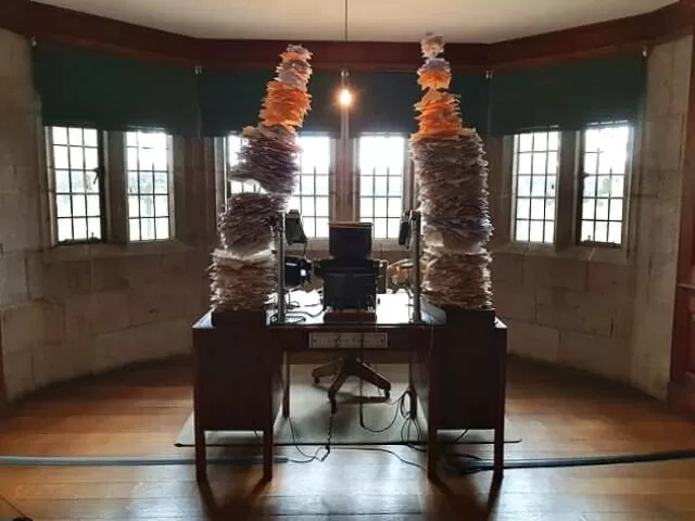piles of planning on desk castle drogo
