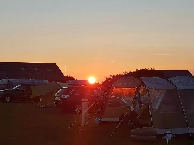sunset over warcombe farm campsite