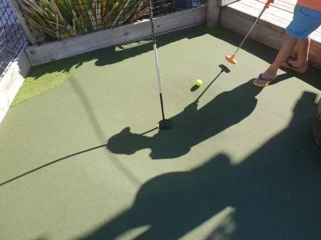 playing crazy golf shadows.