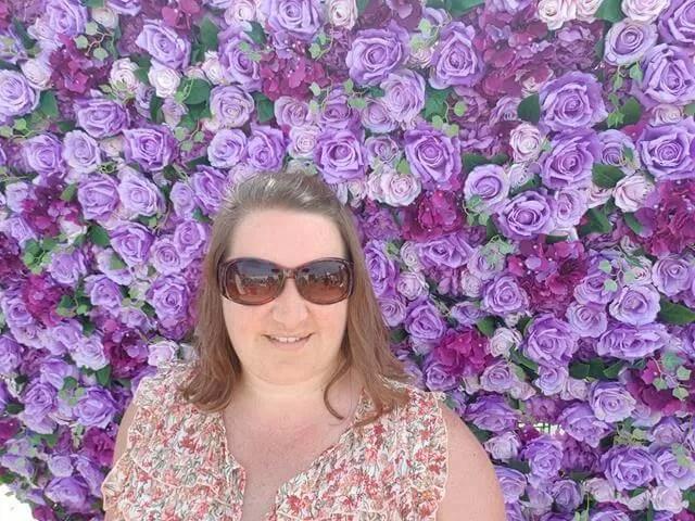 selfie in front of flowers