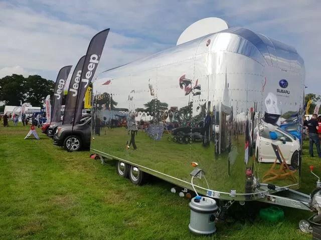 reflections in shiny van
