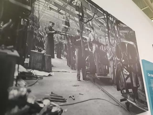 black and white photo of the car factory