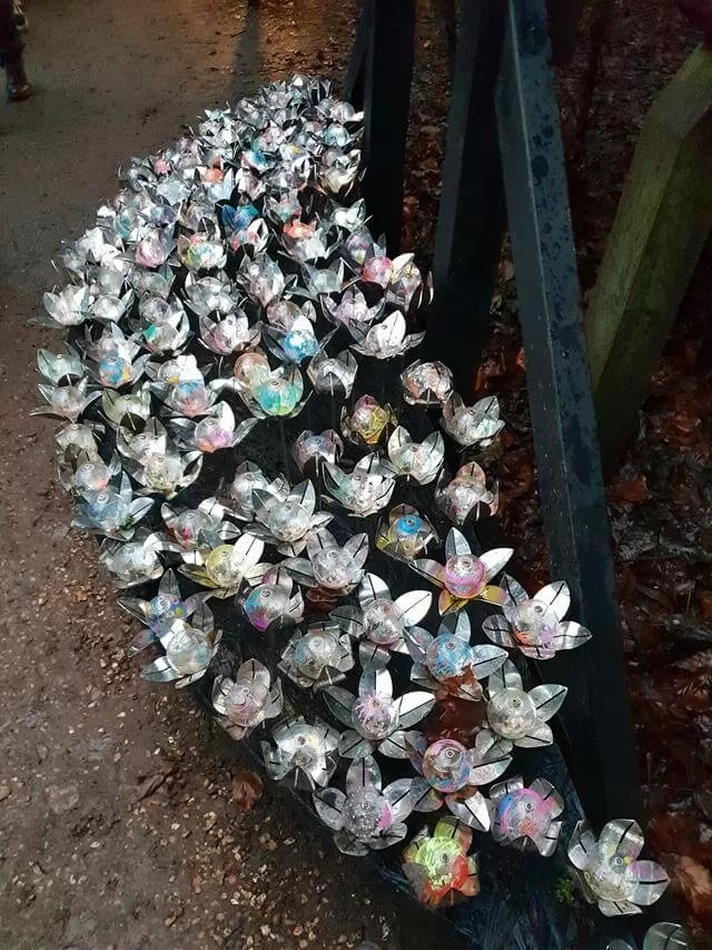 bauble and silver flower decorations at trail entrance