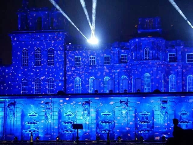 blue lit up on the front of blenheim palace