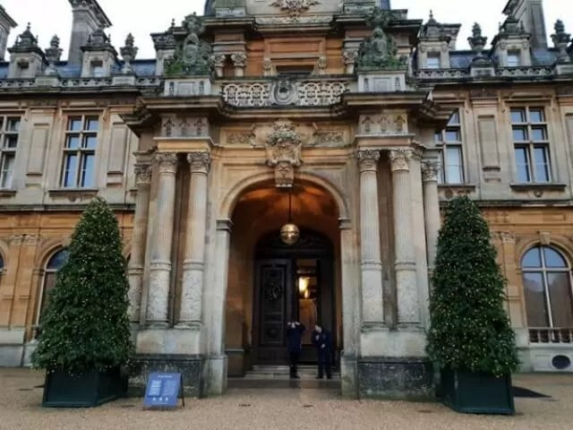 front door at waddesdon with 2 christmas trees