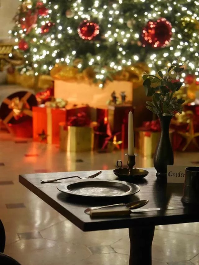 table in front of christmas tree