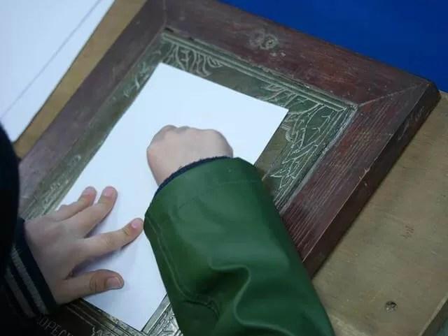 brass rubbing on paper