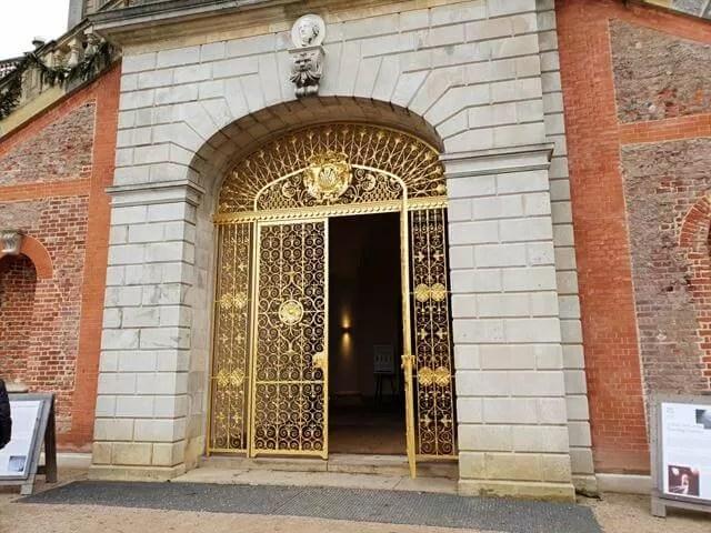 golden archway gates at cliveden