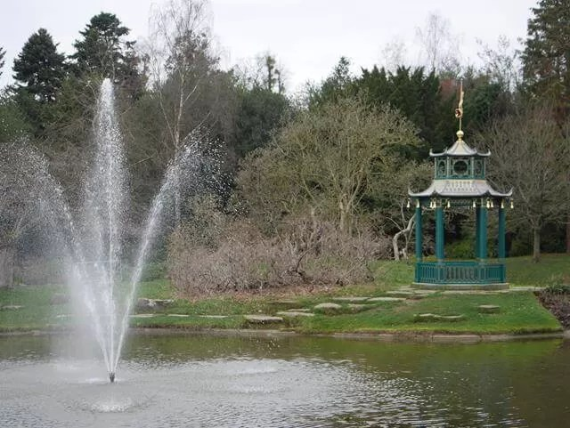 water fountain by a chinese pagoda