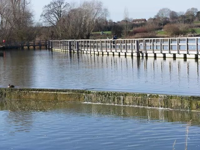boardwalk on lake at wicksteed